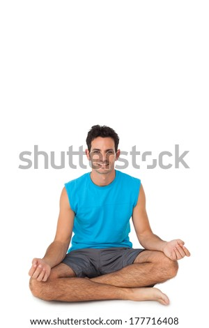 Full length portrait of a sporty young men in lotus pose over white background - stock photo