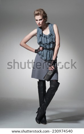 full-length Portrait of a styled professional model. Theme: beauty, posing,  - stock photo