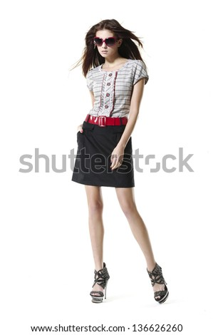full-length portrait of a styled professional model wearing modern sunglasses - stock photo