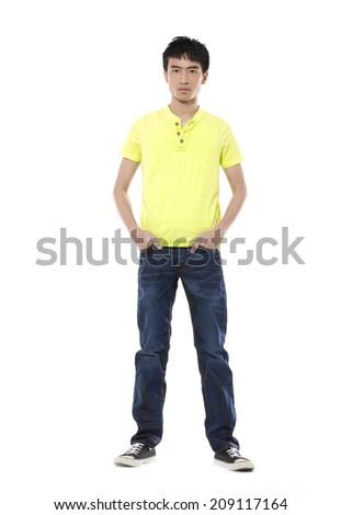 Full length portrait of a stylish young man standing with hands in pockets