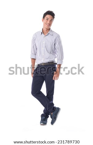 Full length portrait of a stylish young man standing with hands in pockets  - stock photo