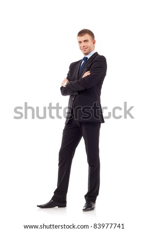 Full length portrait of a successful young business man with hands folded isolated on white - stock photo