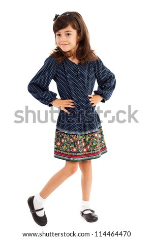 Full length portrait of a sweet little girl with hands on hips isolated on white - stock photo