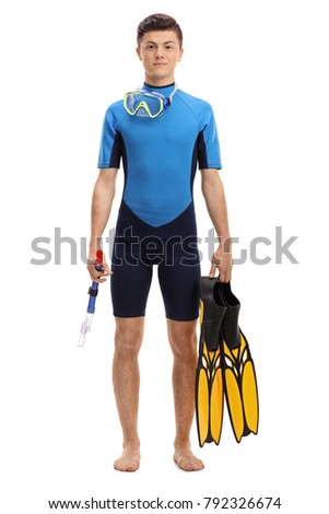 Full length portrait of a teenage boy in a wetsuit with snorkeling equipment isolated on white background