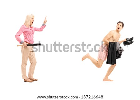 Full length portrait of a woman with baseball bat shouting at a naked guy running away, isolated on white background - stock photo