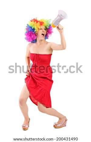 Full length portrait of a woman with wig shouting on a megaphone isolated on white background - stock photo