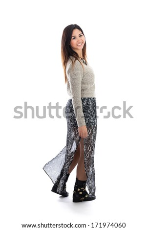 Full length portrait of a young Asian woman wearing a skirt and boots isolated on a white background - stock photo