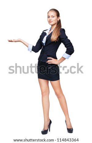 Full length portrait of a young beautiful business woman shows something isolated on white background - stock photo