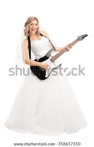 Full length portrait of a young blond bride playing electric guitar isolated on white background - stock photo