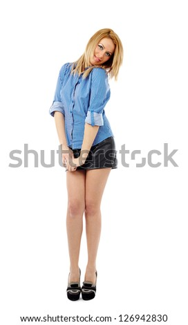 Full length portrait of a young blond businesswoman isolated on white background - stock photo