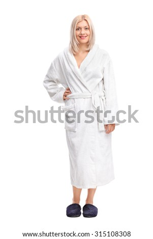 Full length portrait of a young blond woman in a white bathrobe isolated on white background - stock photo