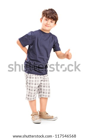 Full length portrait of a young boy giving a thumb up isolated on white background - stock photo
