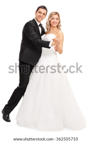 Full length portrait of a young bride and groom dancing together isolated on white background - stock photo