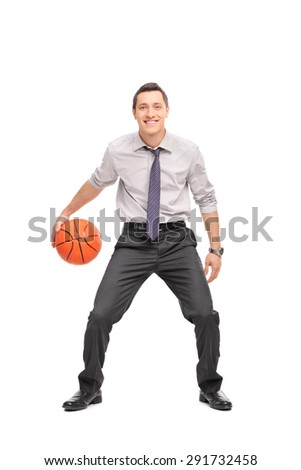 Full length portrait of a young businessman playing basketball and looking at the camera isolated on white background - stock photo