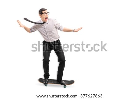 Full length portrait of a young businessman riding a skateboard fast isolated on white background