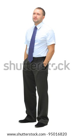 Full length portrait of a young businessman standing with his hands in the pockets