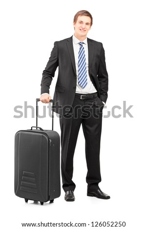 Full length portrait of a young businessman with a suitcase isolated on white background