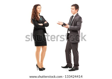 Full length portrait of a young businesspeople having a conversation isolated on white background - stock photo