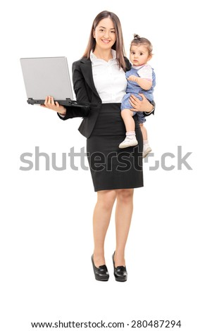 Full length portrait of a young businesswoman carrying her daughter in one hand and holding a laptop in the other isolated on white background - stock photo