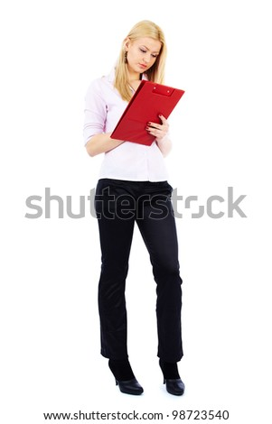 Full length portrait of a young businesswoman writing on a clipboard