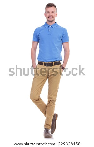 full length portrait of a young casual man smiling for the camera while holding both hands in his pockets. isolated on a white background - stock photo