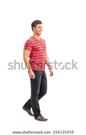 Full length portrait of a young casual man walking isolated on white background