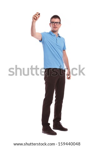 full length portrait of a young casual man writing on an imaginary screen. on white background