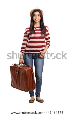 Full length portrait of a young cheerful woman carrying a travelling bag isolated on white background - stock photo
