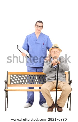 Full length portrait of a young doctor and a senior gentleman posing isolated on white background - stock photo