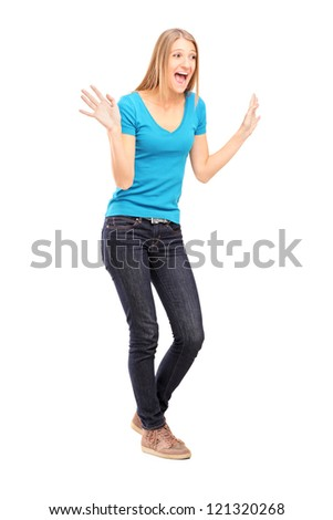 Full length portrait of a young excited woman gesturing isolated on white background - stock photo