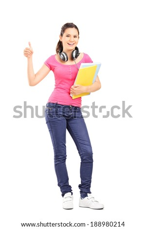 Full length portrait of a young female student giving thumb up isolated on white background
