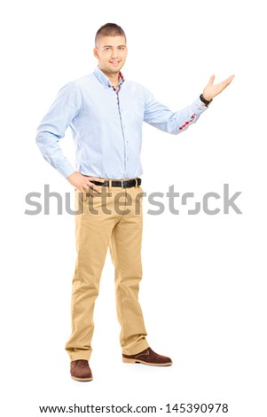 Full length portrait of a young handsome guy gesturing with his hand isolated on white background