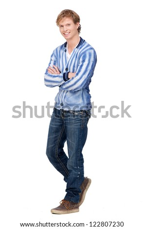 Full length portrait of a young handsome man smiling. Male model has arms crossed, looking at camera and isolated on white background. - stock photo