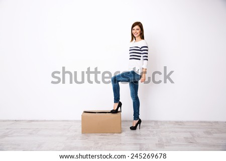 Full length portrait of a young happy woman - stock photo