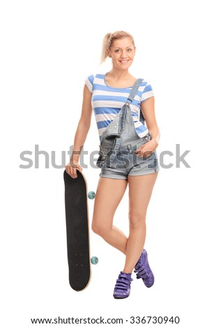Full length portrait of a young hipster girl posing with a skateboard isolated on white background - stock photo