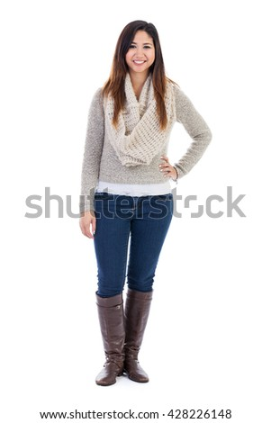 Full length portrait of a young Malaysian woman standing in her 20s wearing winter clothing isolated on white - stock photo