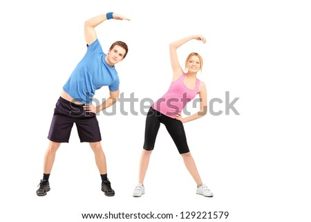 Full length portrait of a young male and female exercising, isolated on white background