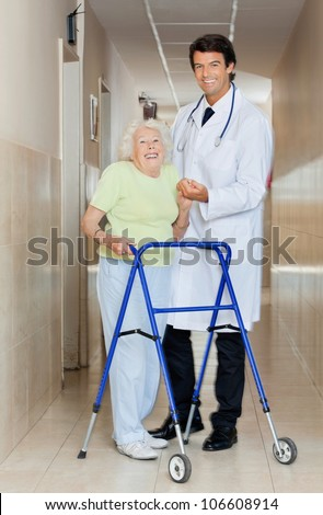 Full length portrait of a young male doctor assisting senior woman with her walker