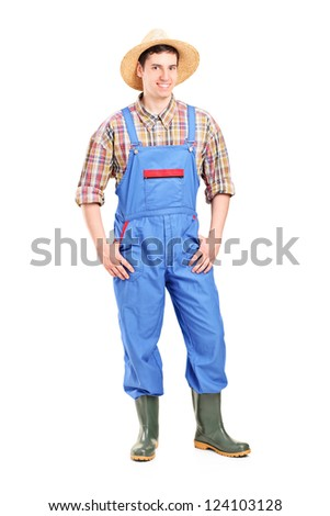 Full length portrait of a young male farmer smiling isolated on white background - stock photo