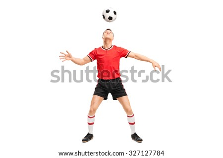 Full length portrait of a young male football player juggling a ball on his head isolated on white background - stock photo