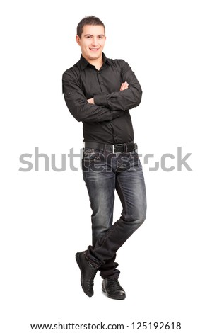 Full length portrait of a young male leaning against wall isolated on white background - stock photo