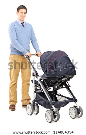 Full length portrait of a young male pushing a baby stroller isolated on white background - stock photo