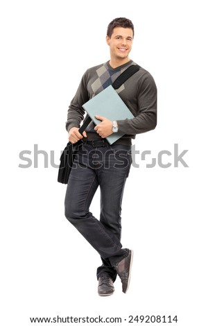 Full length portrait of a young male student holding a notebook isolated on white background