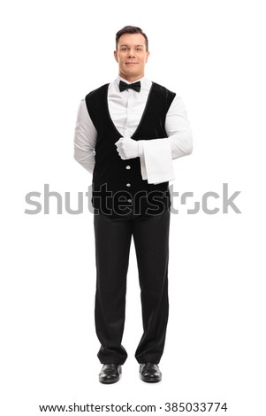 Full length portrait of a young male waiter holding a white towel isolated on white background - stock photo