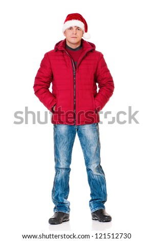 Full length portrait of a young man dressed with winter clothes and Santa hat isolated on white background - stock photo