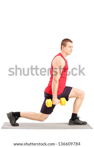 Full length portrait of a young man exercising with weights, isolated on white background - stock photo