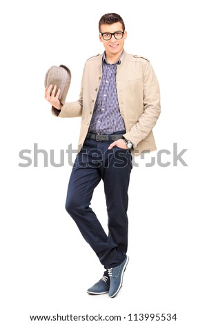 Full length portrait of a young man holding a hat isolated on white - stock photo