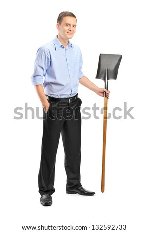 Full length portrait of a young man holding a shovel isolated against white background