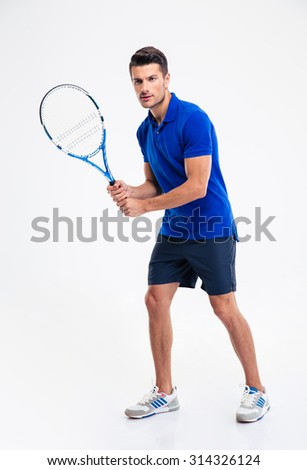 Full length portrait of a young man playing in tennis isolated on a white background - stock photo