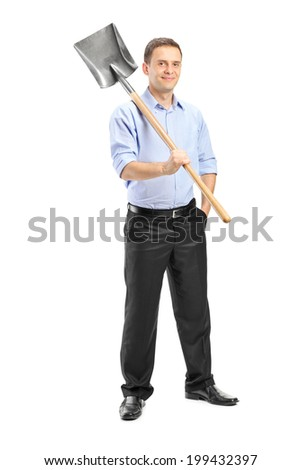 Full length portrait of a young man posing with a shovel over his shoulder isolated on white background